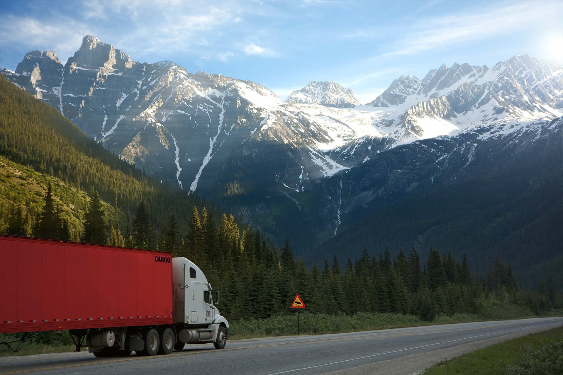 Truck driving through mountains